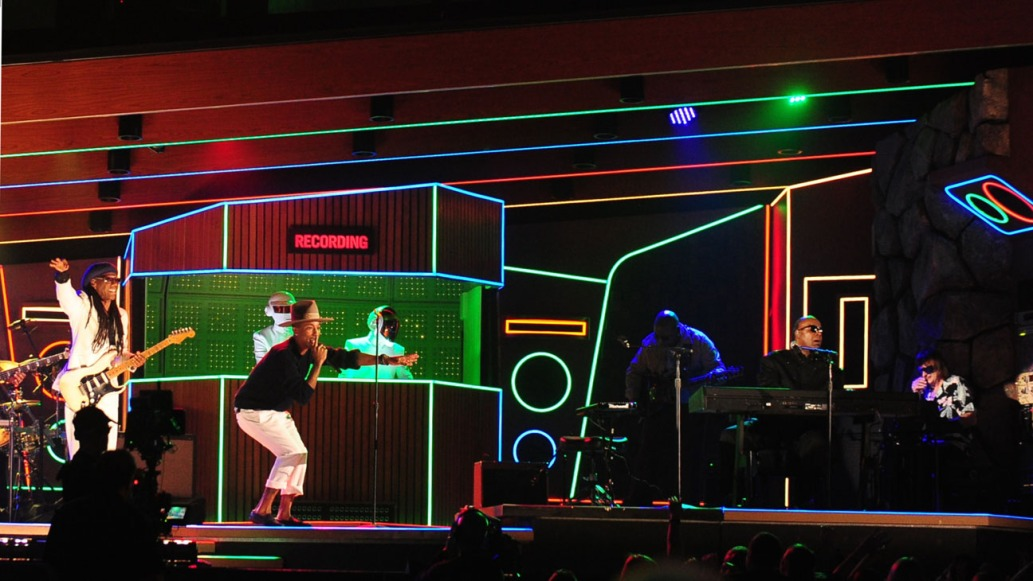 Pharell Williams performs with Daft Punk and Stevie Wonder during the 56th Grammy Awards at the Staples Center