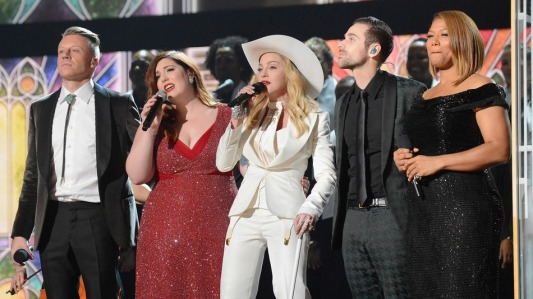 Rapper Macklemore, singers Mary Lambert and Madonna, musician Ryan Lewis and Queen Latifah perform onstage during the 56th Grammy Awards at the Staples Center.
