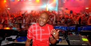 DJ Des Mitchell spinning music at a Rave