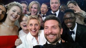 """This image released by Ellen DeGeneres shows actors front row from left, Jared Leto, Jennifer Lawrence, Meryl Streep, Ellen DeGeneres, Bradley Cooper, Peter Nyong'o Jr., and, second row, from left, Channing Tatum, Julia Roberts, Kevin Spacey, Brad Pitt, Lupita Nyong'o and Angelina Jolie as they pose for a """"selfie"""" portrait on a cell phone during the Oscars at the Dolby Theatre."""