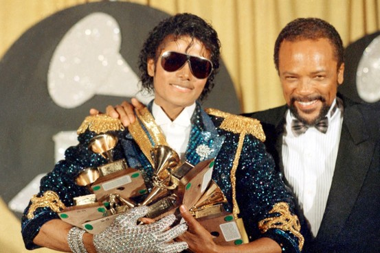 Michael Jackson wins a record breaking eight Grammys for his album